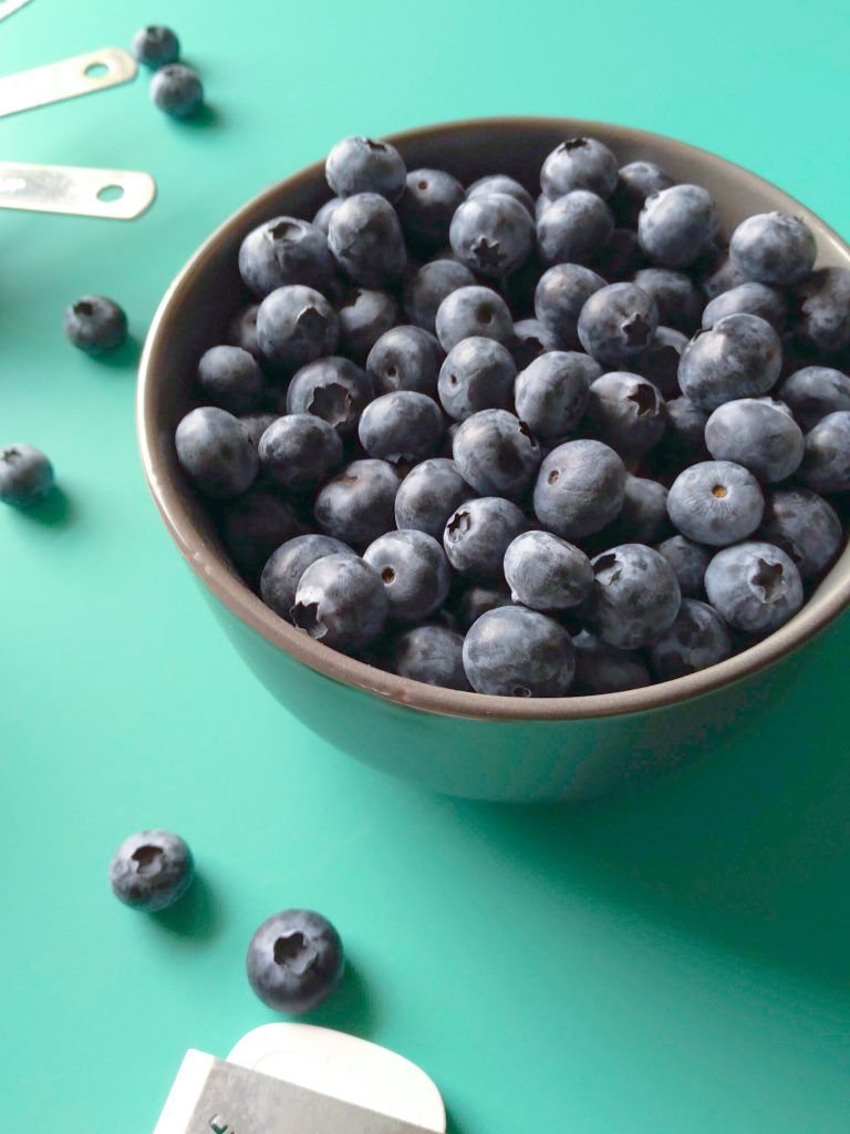 blow of blueberries on a blue backdrop